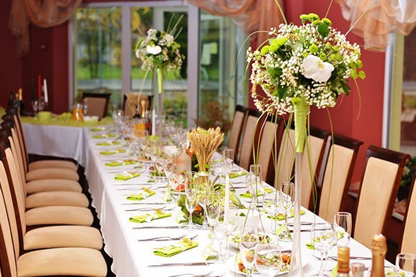 Dining table decoration with food and flowers