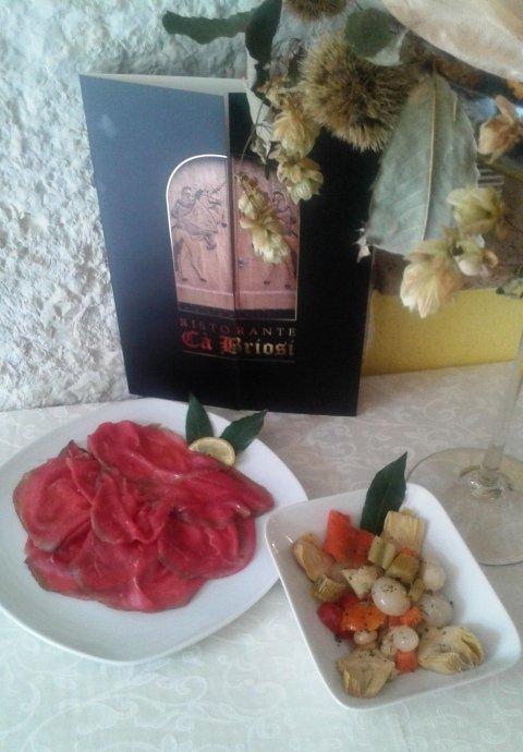 Carpaccio di carne salada con olio extravergine di oliva del Garda e verdure dellorto sott olio
