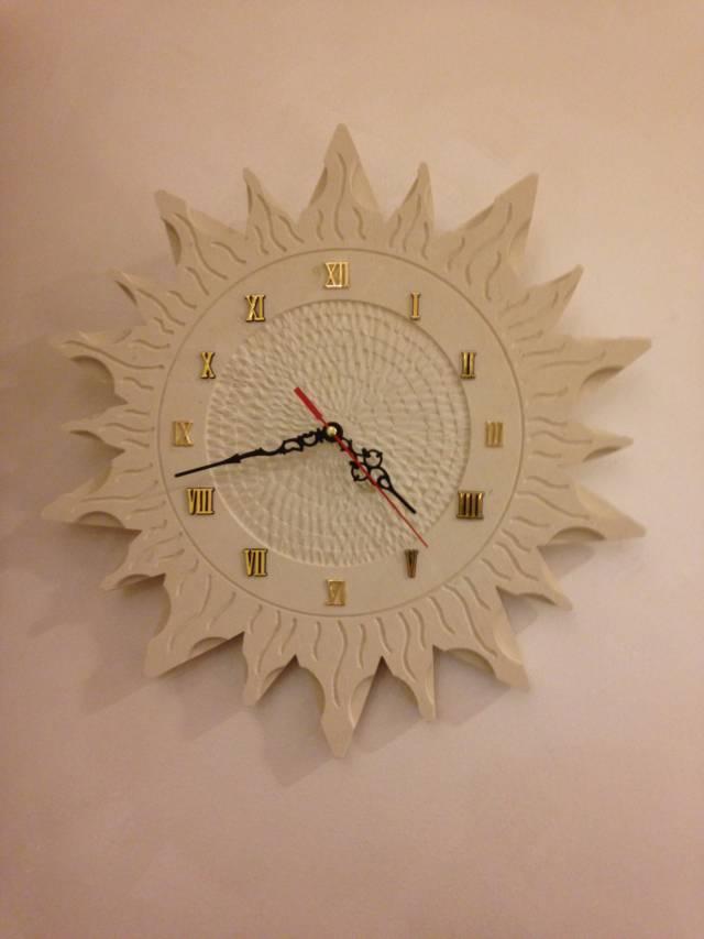 Orologio a forma di sole