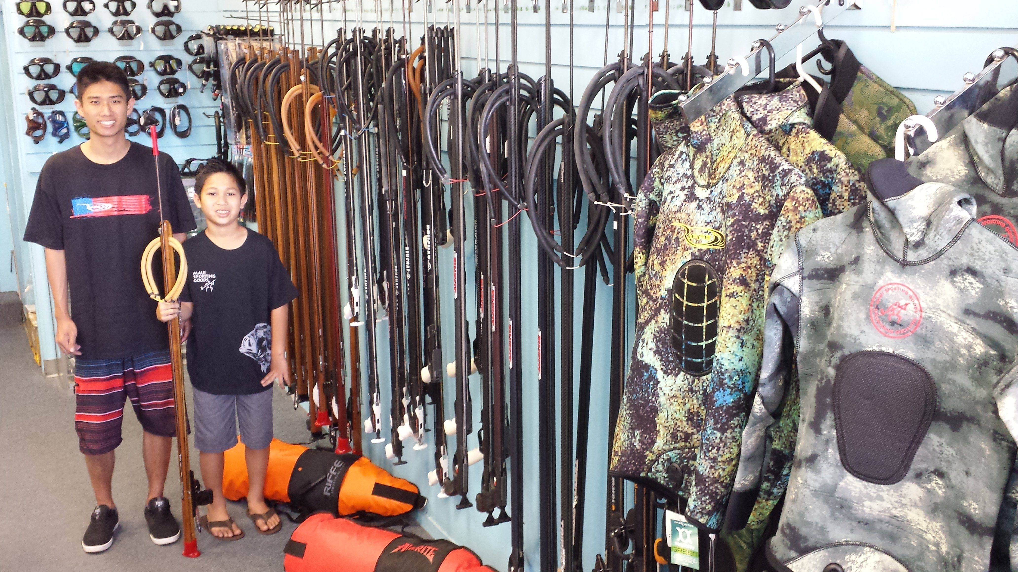 Diver with spear doing spearfishing in Honolulu, H