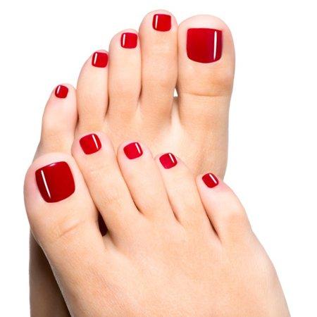 smalto rosso sulle dita dei piedi