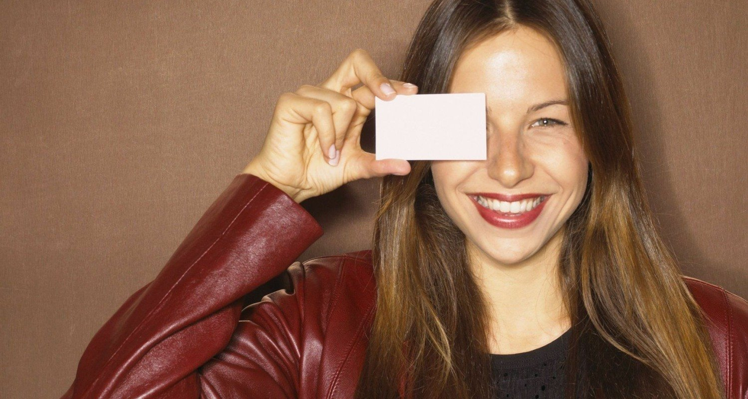Girl holding business card