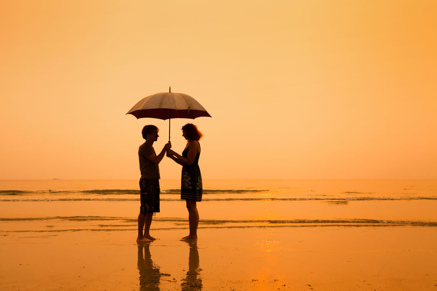 Couple at beach during sunset