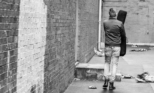 musician walking away