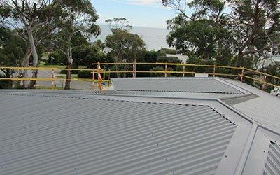 coastal roofing grey roof yellow railing