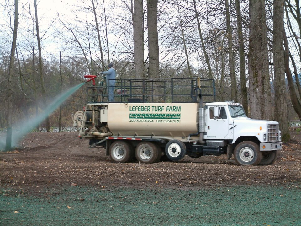 Lefeber Turf Farm hydroseeding the ground, using the sprayer on the truck- Mount Vernon Washington
