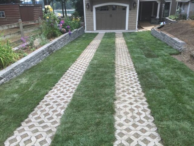 Pavers inset in lawn to drive on.  Grass driveway to the garage.
