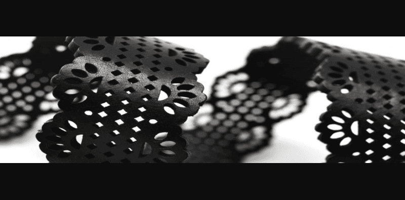 pelle nera decorata a laser