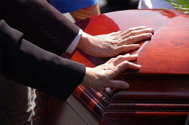 caring funerals hands coffins