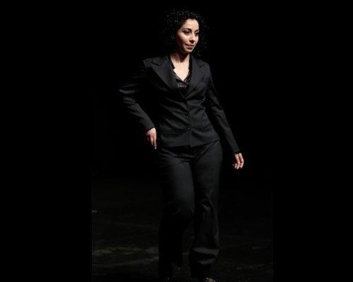 Tailleur nero con pantalone a palazzo