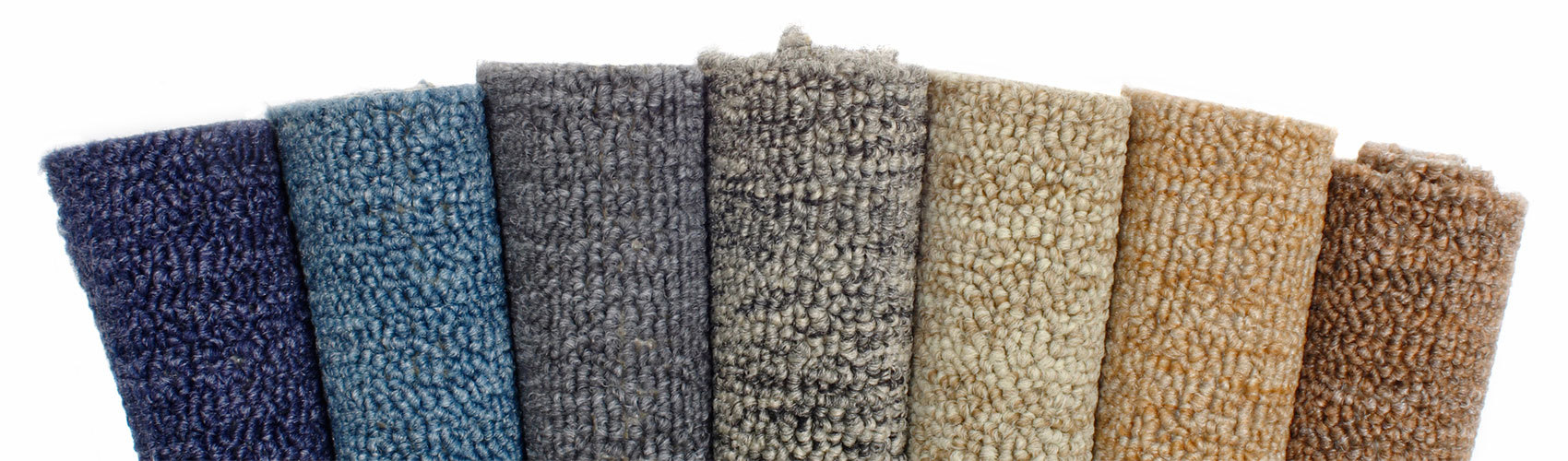collection of rolled carpets