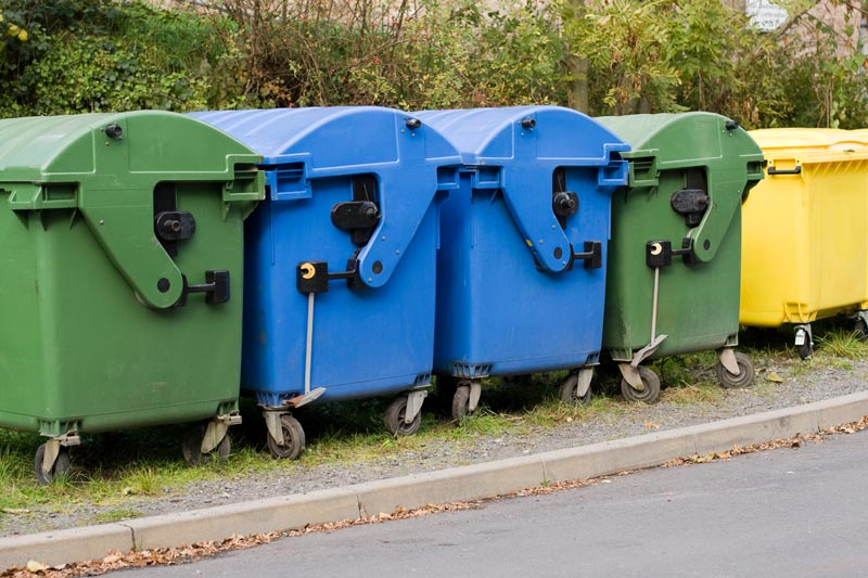 lightning bin hire two blue paper containers yellow recycling container and two containers for organic waste