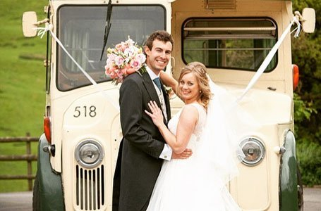 Couple posing in front of the bus