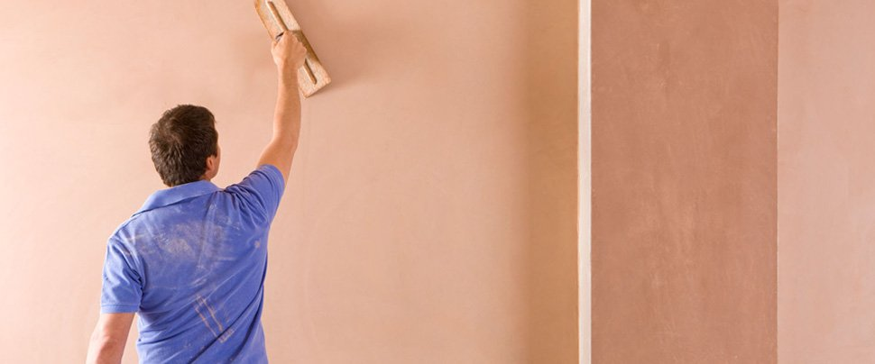 A man plastering a wall