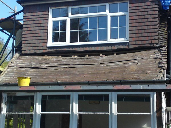 A roof in desperate need of repair by All Roofing & Guttering