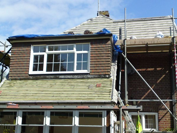 A roof under construction by All Roofing & Guttering