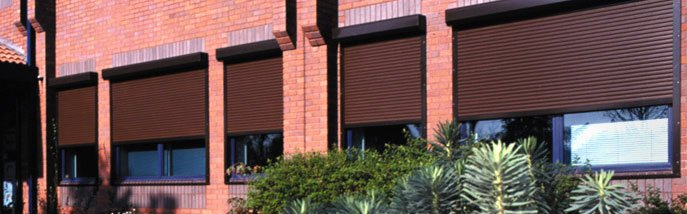 Window shutters Hampshire - Winchester - Britannia Security Shutters - Built in shutters on an office building