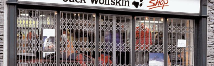 Shopfront shutters - Winchester - Britannia Security Shutters - White shop front shutter