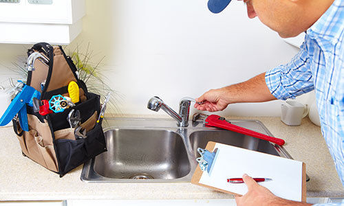 One of our plumbing contractors fixing a sink in Mooresville, NC