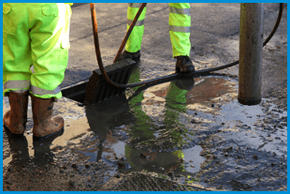 a street drain being cleared