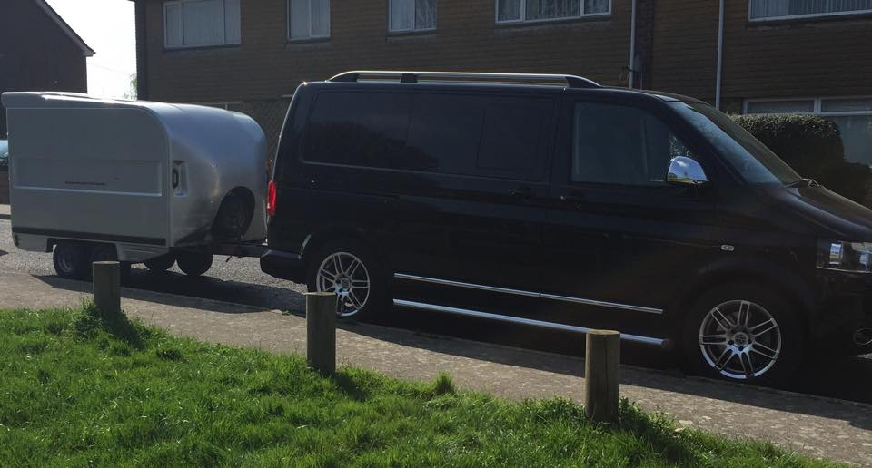 Black  VW Transporter with pink ribbons on it
