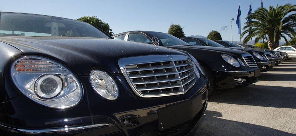 A row of Mercedes saloons