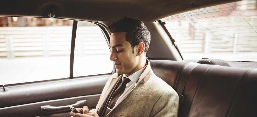 Young businessman in the back of a car