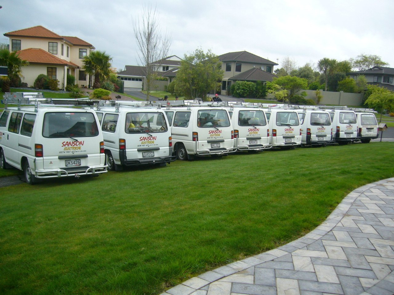 Sanson electrical van parked together