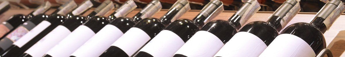 sample wine and platters row of wine bottles
