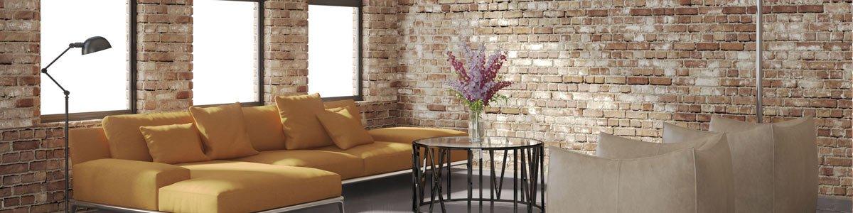comco restoration brick wall with orange sofa