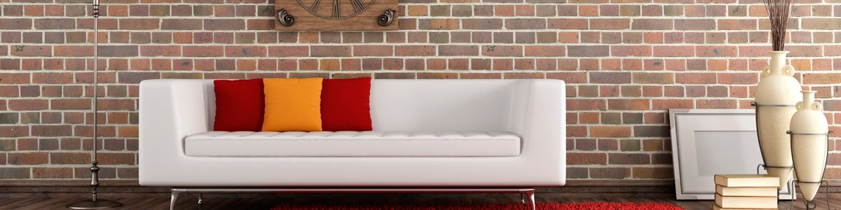 comco restoration brick wall with sofa in hall
