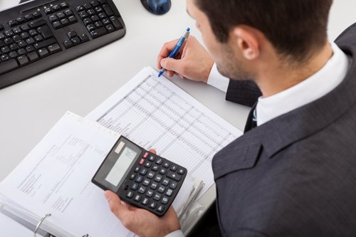 Tax professionals calculating tax