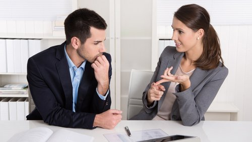 Tax professional discussing about tax with her client