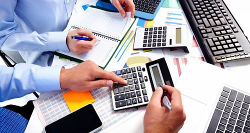 Financial experts calculating tax