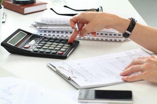 Tax professional calculating tax