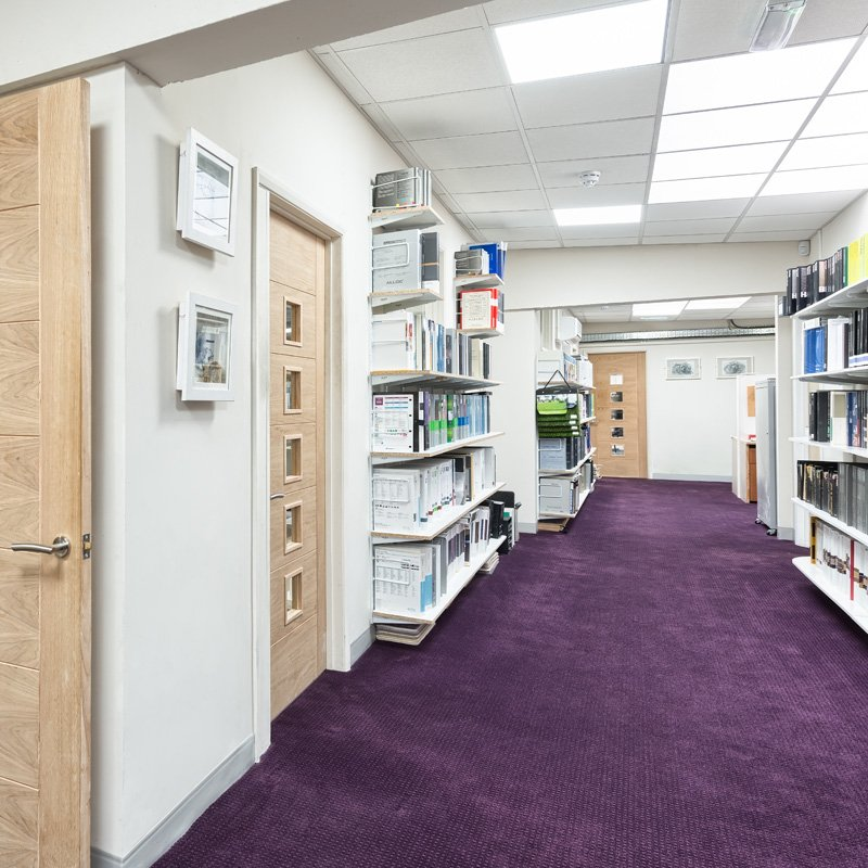 purple carpet installed in library