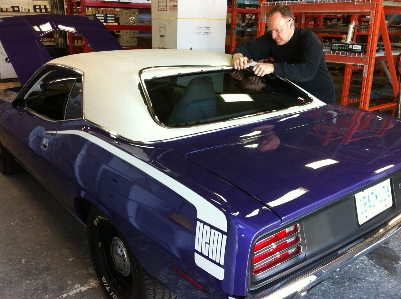 Replacement of back window with chrome trim surround on this classic 1971 Cuda.