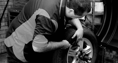 man fixing tyre