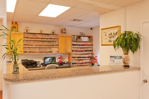 Dentist office employee and child prepare for braces in Pearl City, HI