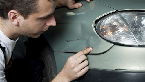 mechanic working on accident repairs in Chillicothe, OH