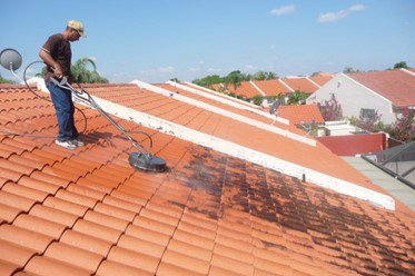 man cleaning the roof