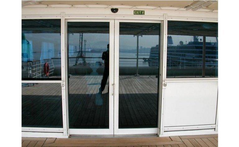 Sistema di porta speciale inox con automatismo 7
