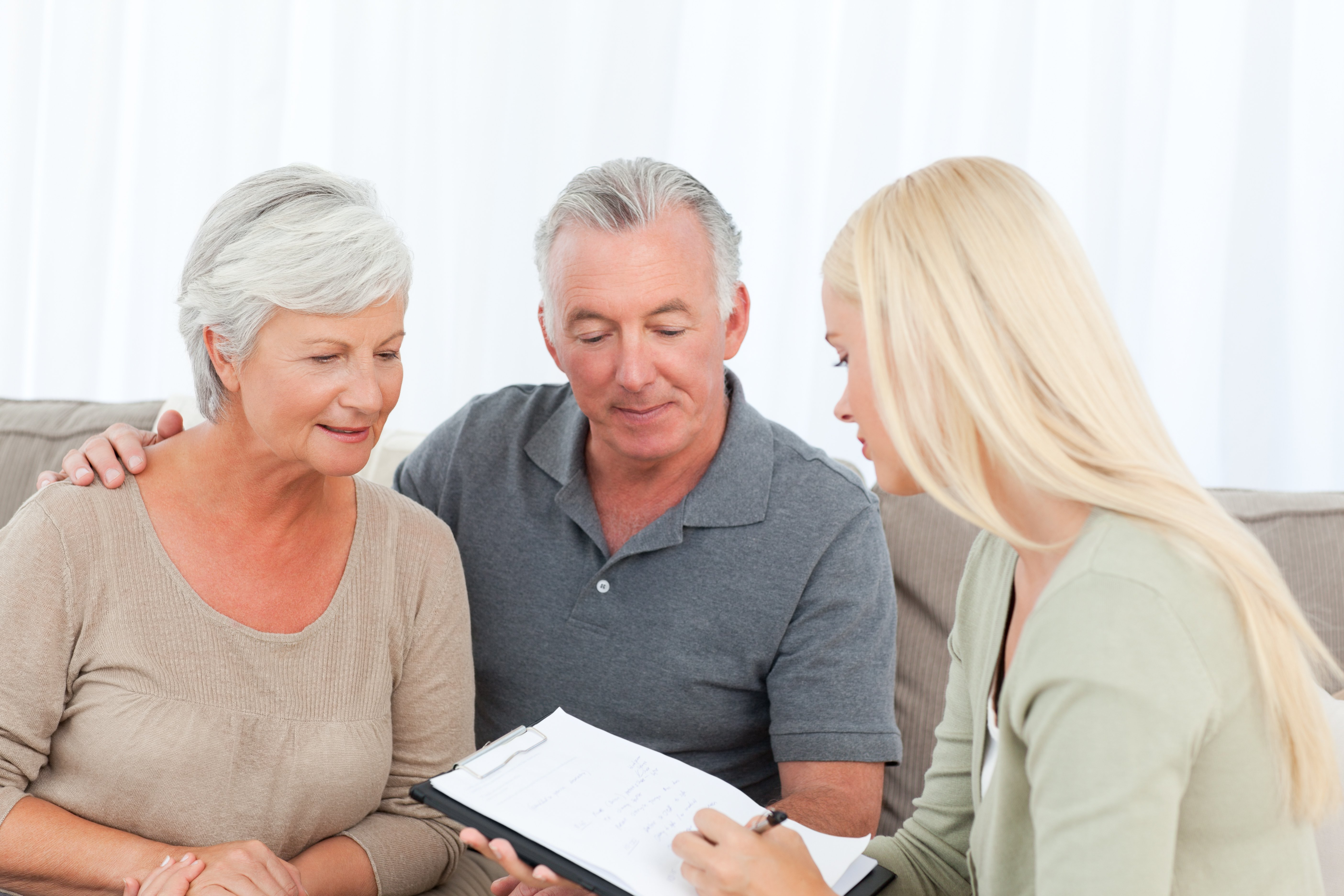 Lawyer explaining paperwork to an older couple