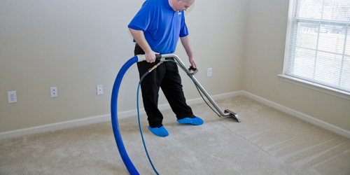 Professional providing affordable carpet steam cleaning in Lincoln, NE