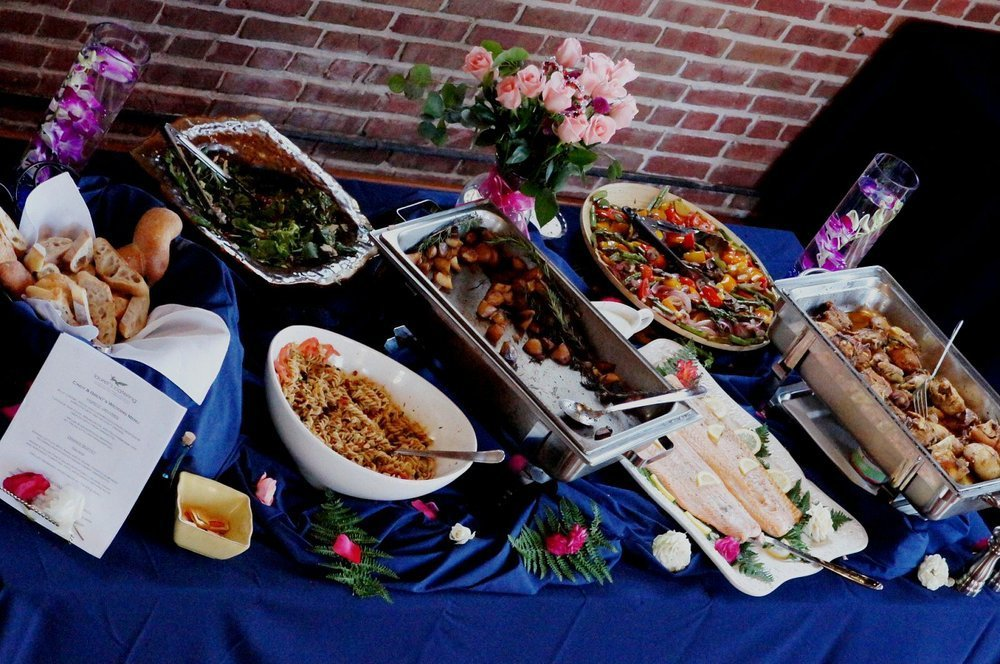Various dishes served on the table with blue cloth