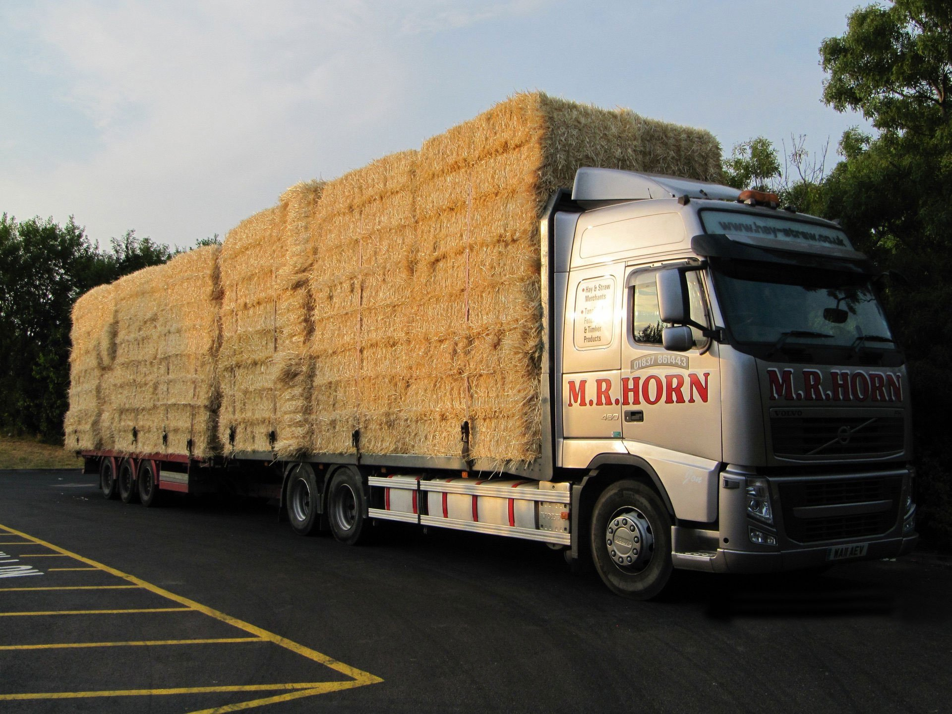 a moving lorry supplying hay
