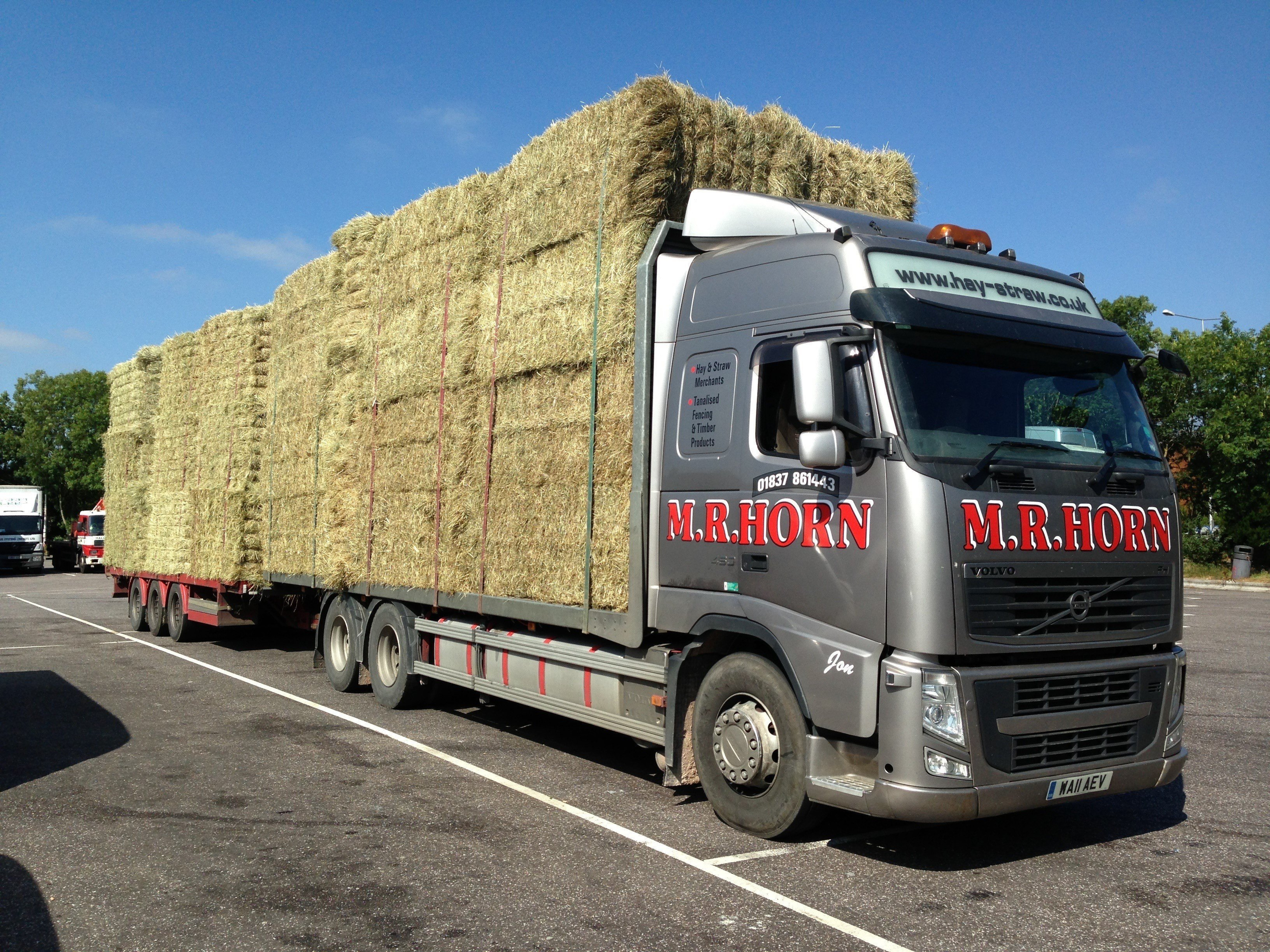 grey coloured lorry for transporting hay