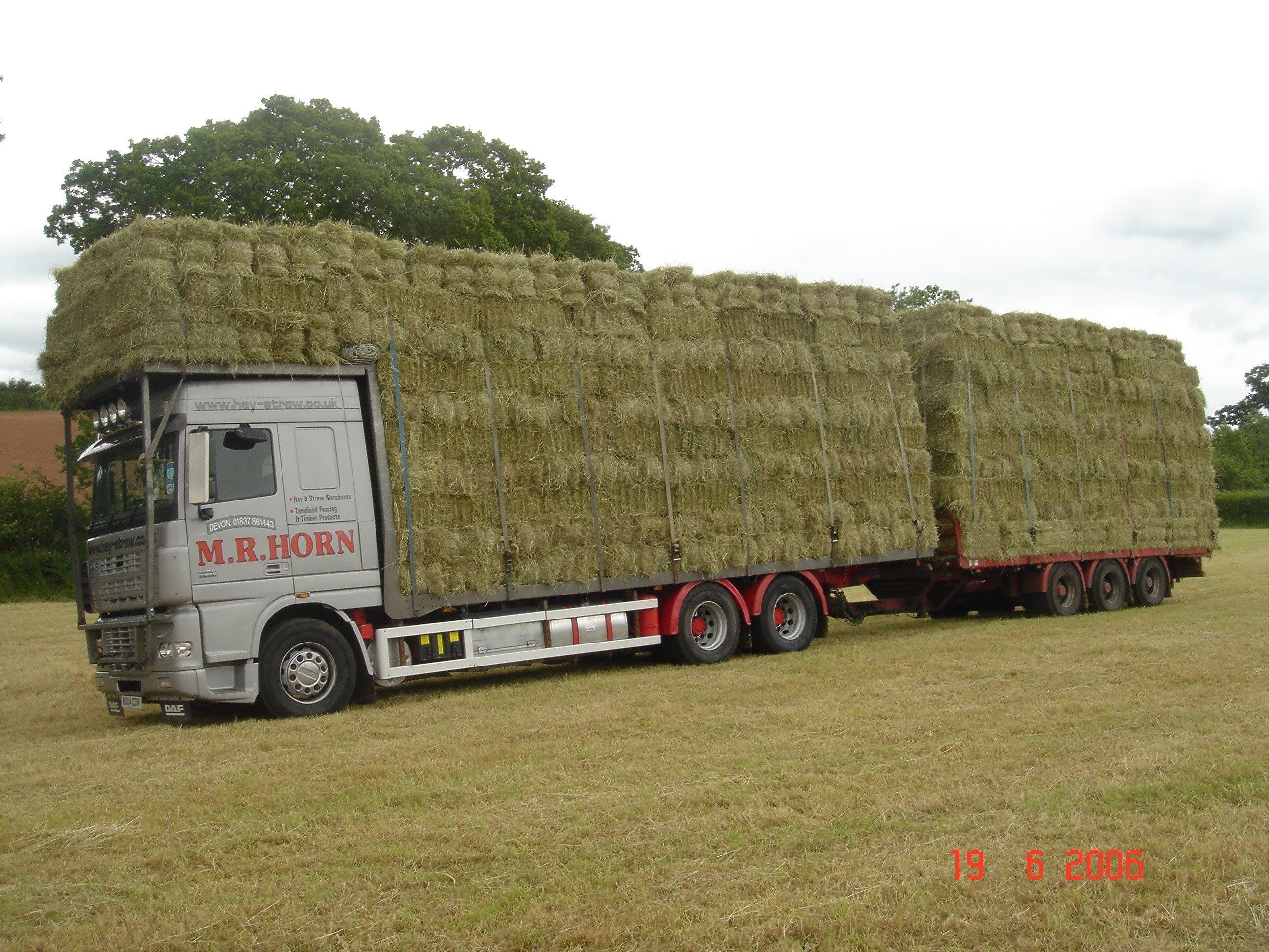 huge truck carrying hay