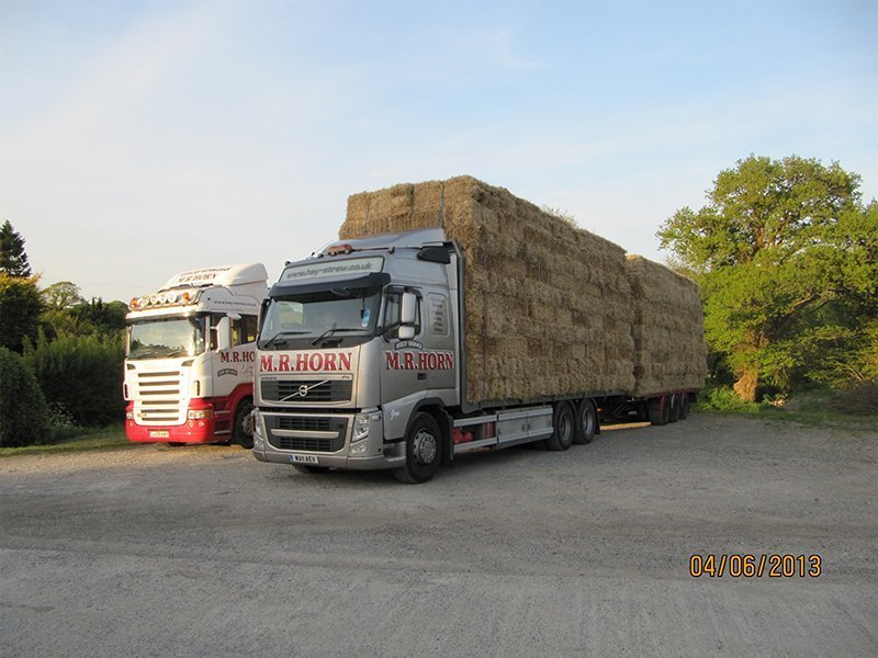 multiple lorries transporting hay