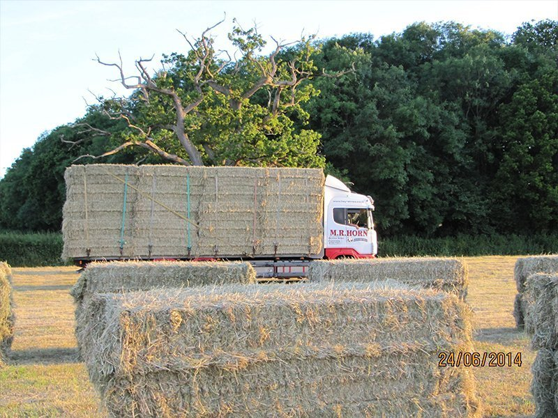 moving truck supplying straw